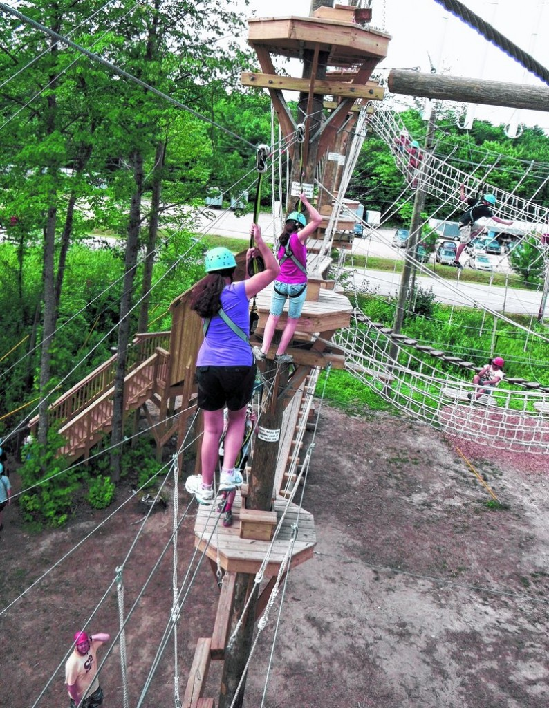 Tightrope crossings at Monkey Trunks in Saco take some balance, and grabbing pulley clips helps.
