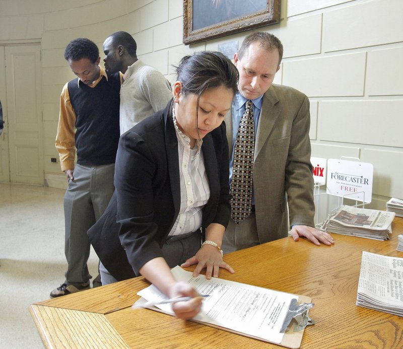 Jenna Vendil signs an affidavit to let noncitizens vote in city elections. That failed, but sponsors of a different drive want the same time limits for their effort.