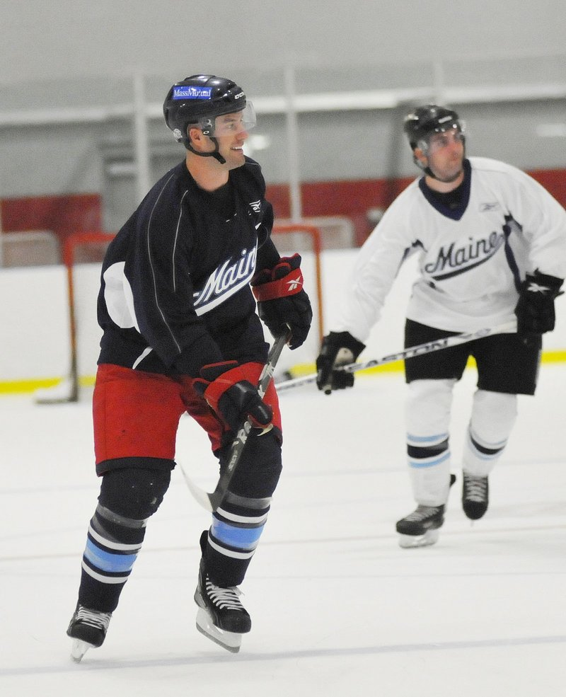 Greg Moore was a Hobey Baker finalist in 2006. Now he's trying his hand in the overseas game as he starts his first season with Augsburg, a city 80 miles from Munich.