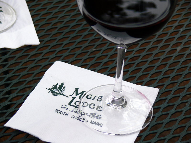A glass of wine enjoyed outdoors adds to the meal.
