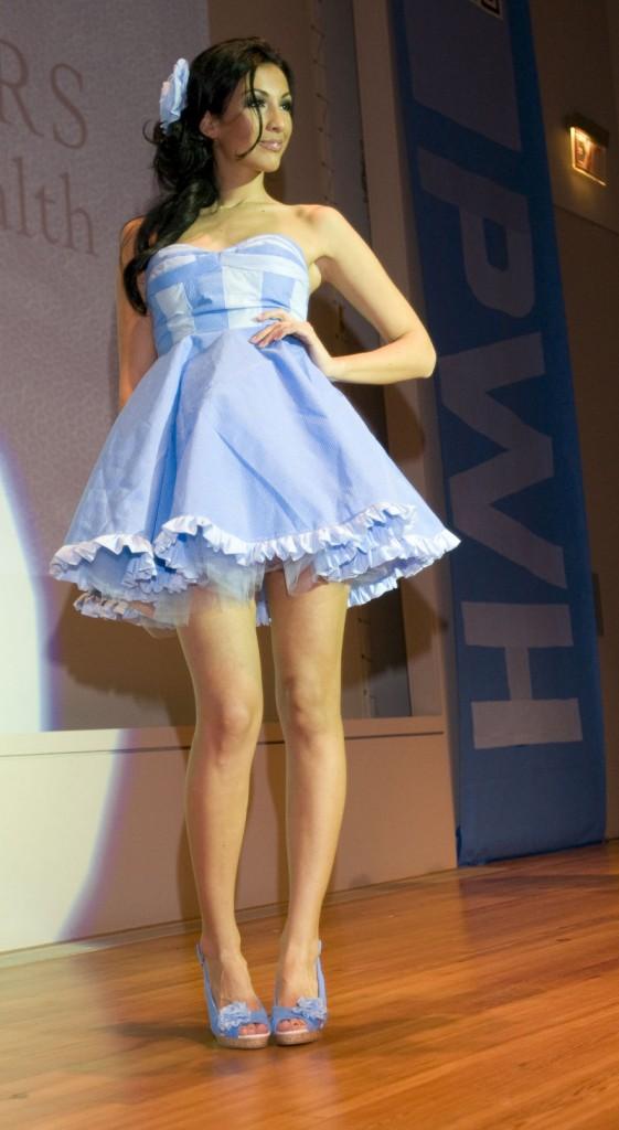 Erika Lynn Smith's 1950s-style minidress with flared petticoat was modeled by Miss Maine U.S. Aleksandra Derikonja.