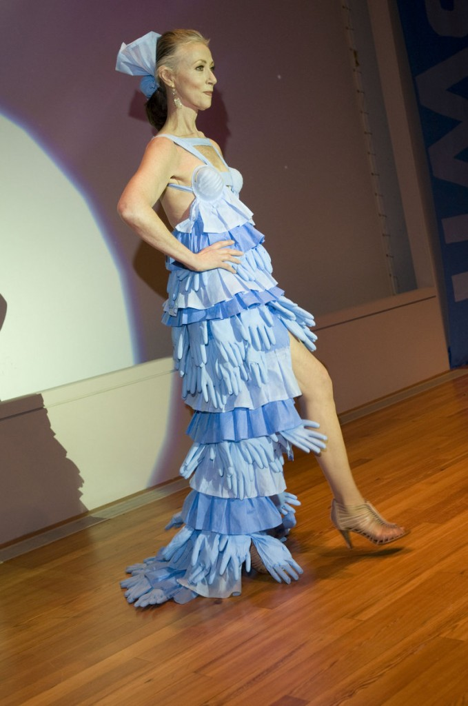 Mardie Weldon's dress of blue surgical gloves interlaced with blue wrap features a long-tailed skirt with a very short front and strategically placed blue surgical masks.