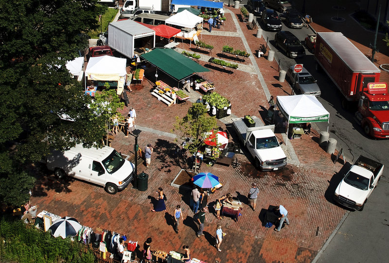 The farmers market in Monument Square has grown to include not only farmers, but also vendors and performers. A new effort may bring an international flavor to Monday's market.