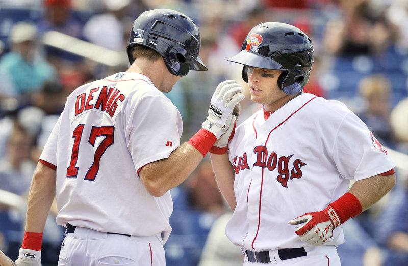 Jeff Howell, right, of the Portland Sea Dogs is congratulated by teammate Mitch Dening after hitting a fourth-inning home run with nobody on at Hadlock Field.