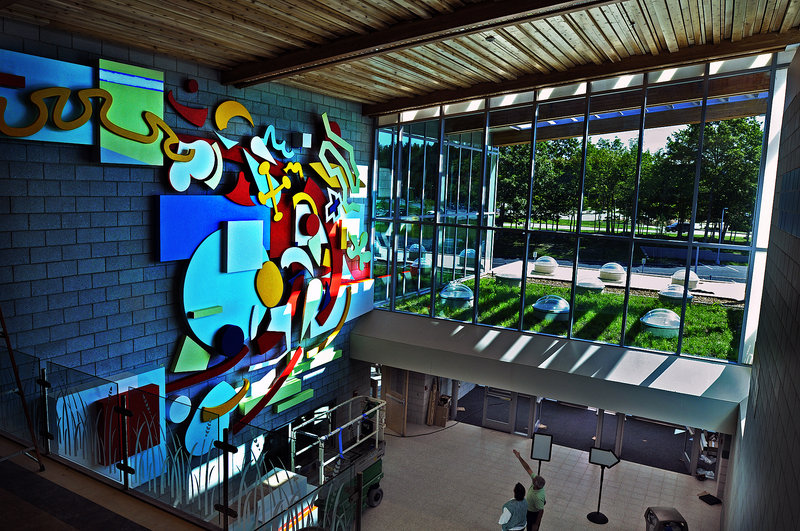 The lobby of the new Falmouth Elementary School is designed to allow light to stream into the entryway and hit the artwork on the far wall.