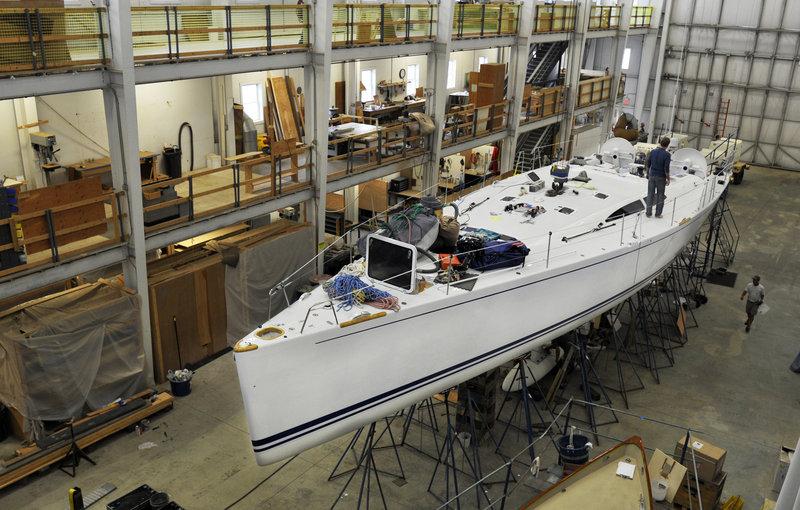 Lyman-Morse employees work on the Baraka, a racer-cruiser yacht built by the Thomaston-based company in 2006.