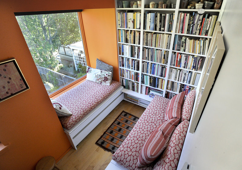 Among the features added when Portland architectural designer Jeremy Moser tackled the renovation are a cool second-floor book nook/guest sleeping space ...