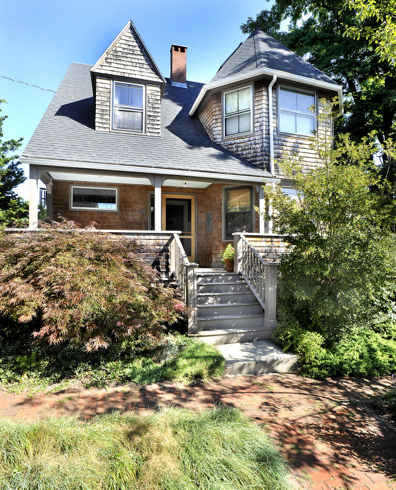 Margo Halverson and Charles Melcher's Portland home was designed by John Calvin Stevens. The front facade evokes the renowned architect's signature style.
