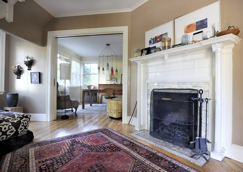 The living room, with its fireplace and elegant flow, is part of the original space designed by John Calvin Stevens.