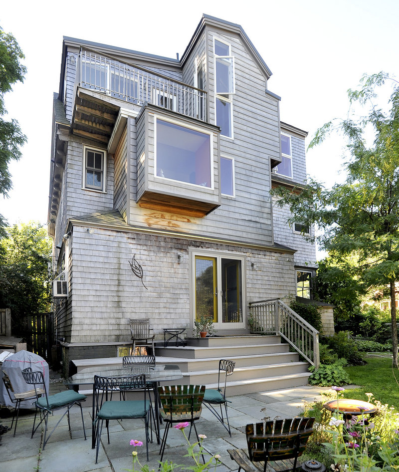 The rear of the house has an edgier, more modern look, thanks to a three-story addition that suits the owners' needs as work-at-home graphic artists.