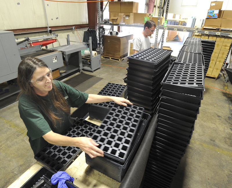 "Julie Dresser assembles starter kits at Grow-Tech, which produces 50 million ""grow plugs"" a year. The company recently relocated to a 30,000-square-foot building in South Portland from a smaller facility in Lisbon Falls."