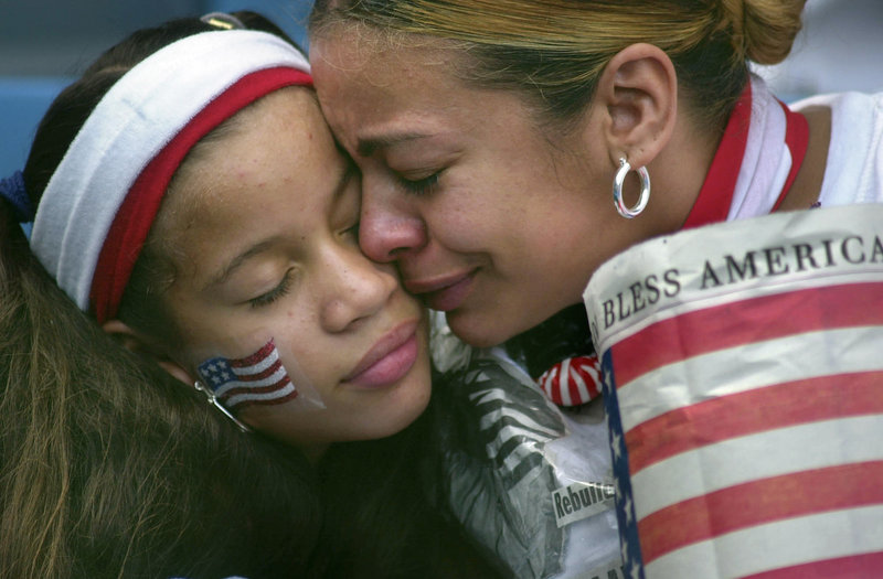 In the days after the terrorist attacks of Sept. 11, 2001, The Portland Press Herald sent columnist Bill Nemitz and photographer Gregory Rec to New York to report from the scene. This is one of the photos from that report: Frances Ortega of the Bronx hugs her daughter Quasha at the start of the