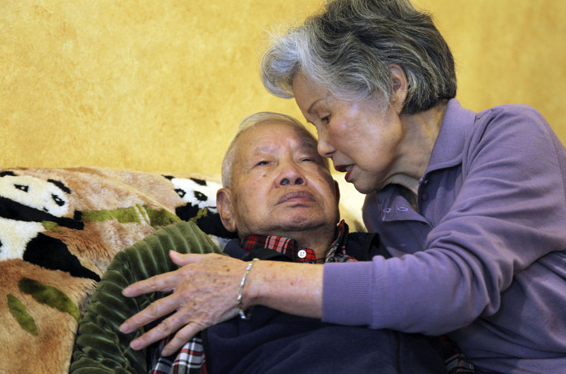 Shou-Mei Li cares for her husband, Hsien-Wen Li, an Alzheimer's patient, in their San Francisco home. About 5.4 million Americans have Alzheimer's or similar dementia.