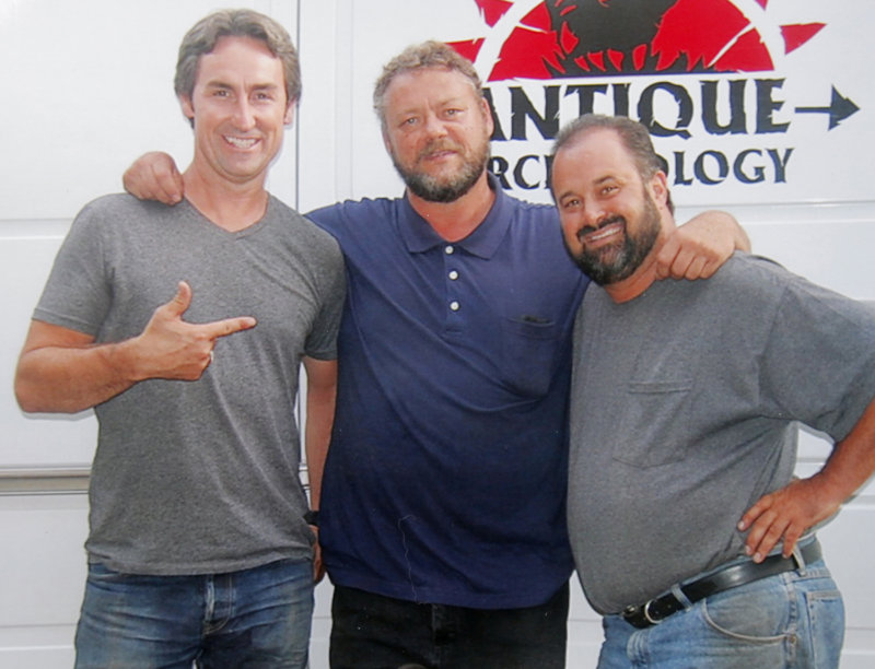 """Mario Binette, center, says """"American Pickers"""" hosts Mike Wolfe, left, and Frank Fritz were """"just as crazy and nutty as they are on TV"""" when they visited his business in Arundel last week."""