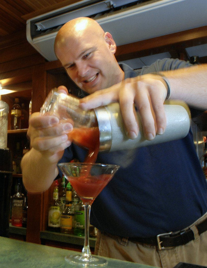 Charles Nedzbala, a bartender at the West Meadow Pub at the Meadowmere Resort in Ogunquit, uses his own lobster vodka to make a Bloody Mary.