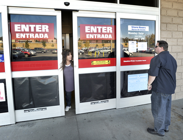 An unidentified store employee today directs vendor David Lamb of Blue Rock Industries to a back entrance at the now-closed Lowe's in Biddeford.