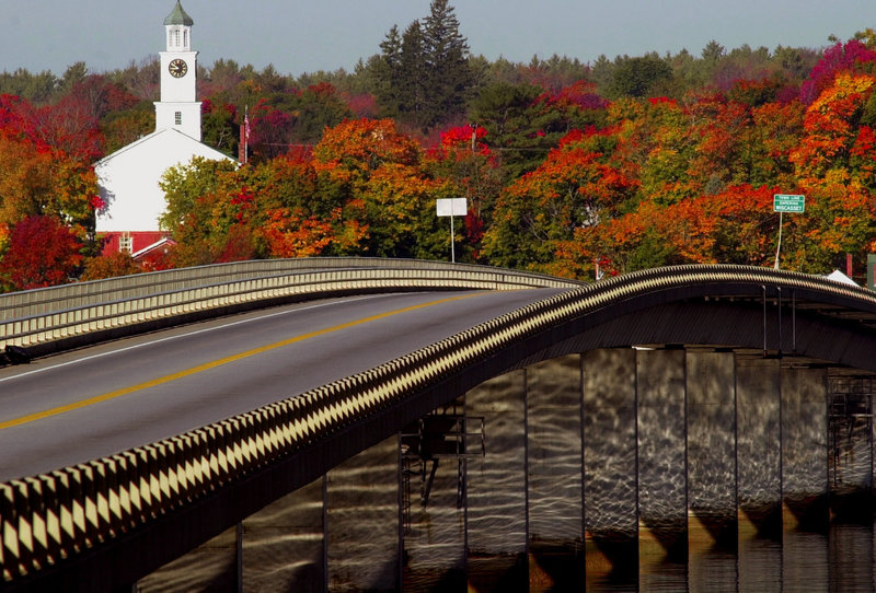 Foliage colors the countryside beyond the bridge that connects Edgecomb and Wiscasset.