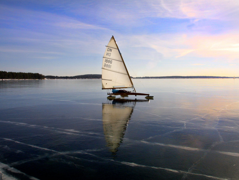 An ice boater sails on Sebago Lake in a DN class boat.
