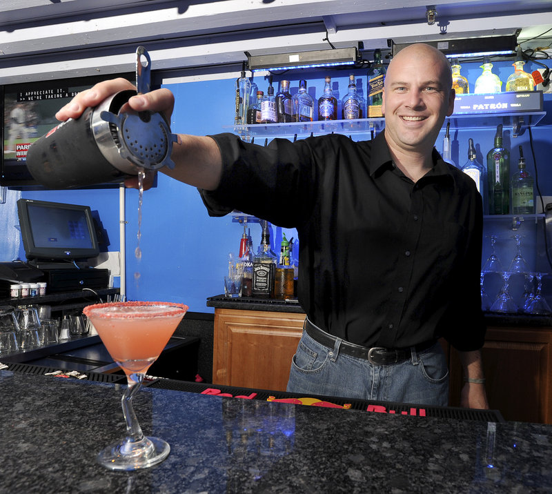 Bartender Charles Nedzbala makes a ultimate cosmo at FortiFem Martini Lounge in Portland.