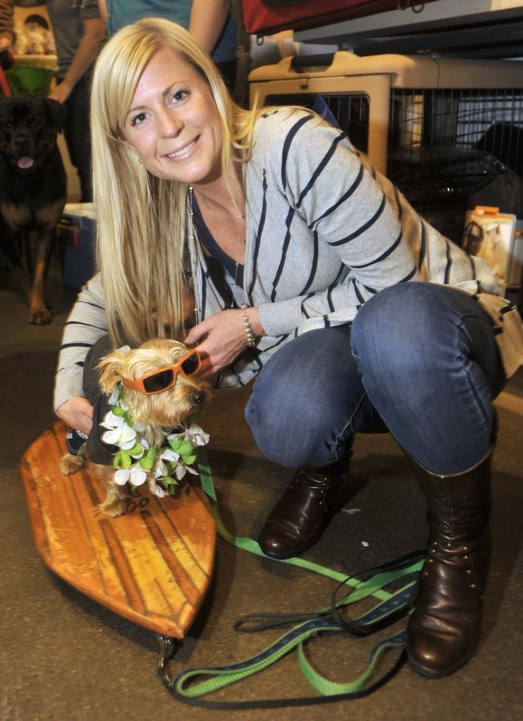 "Ashlee Sawyer of Portland with her ""surfer dude"" dog, Oliver, at last year's Planet Dog party."