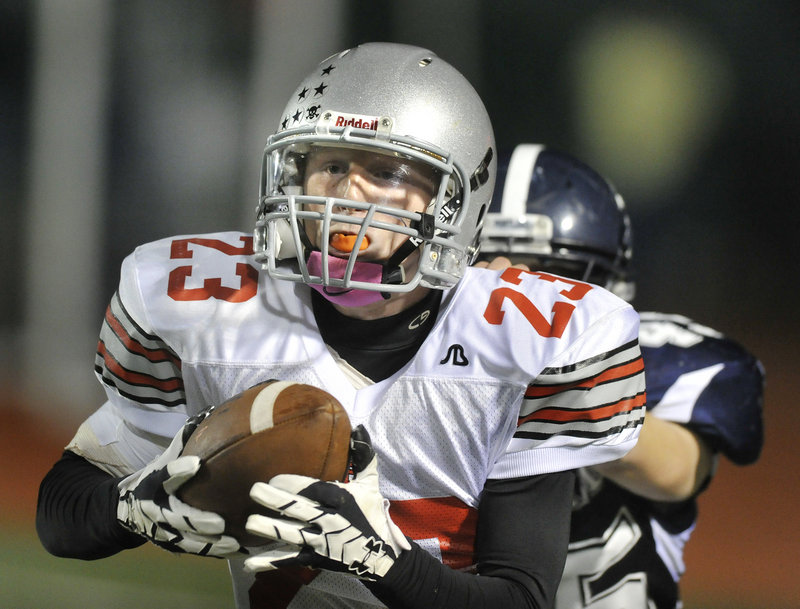 Hayden Owen of South Portland steps in front of a receiver Friday night to intercept a Portland pass in the closing seconds of the first half Friday night. The Riots returned two interceptions for touchdowns in the second half and rallied to a 20-7 victory at Fitzpatrick Stadium.