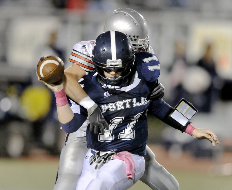 Brendan Horton, who returned a pass for a South Portland touchdown, sacks Portland freshman quarterback Ryan Ruhlin.
