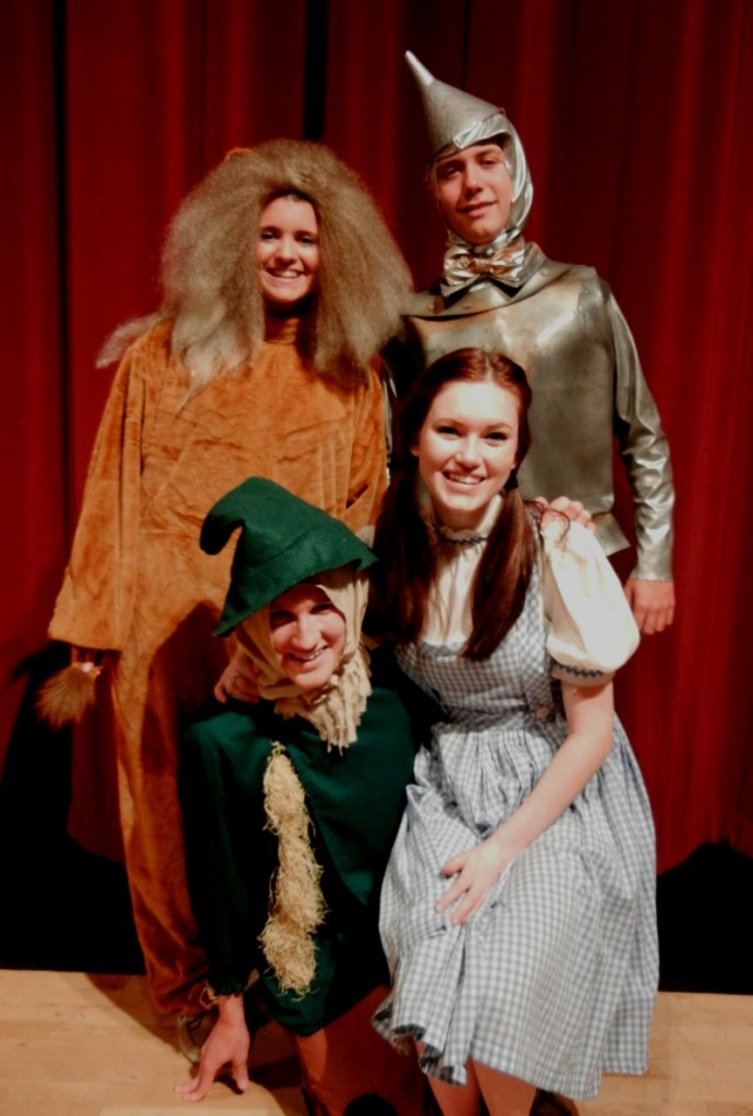 """The Cowardly Lion, Tin Man, Scarecrow and Dorothy Gale (Whitney Bolduc, Jamie McBride, Brad Meader and Georgia Noonan, respectively) pause for a picture while rehearsing Windham High School's """"The Wizard of Oz."""""""