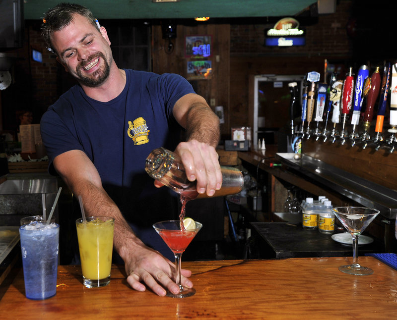 Tim Roberge sets a fast pace behind the bar at Mulligan's in Biddeford.