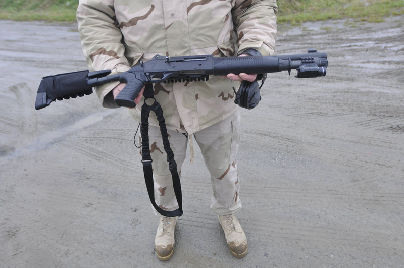 Lt. Gary Hutcheson, a Portland police firearms instructor, shows a Benelli M4 12-gauge shotgun during training. The weapon is safer than others for police in an urban setting.