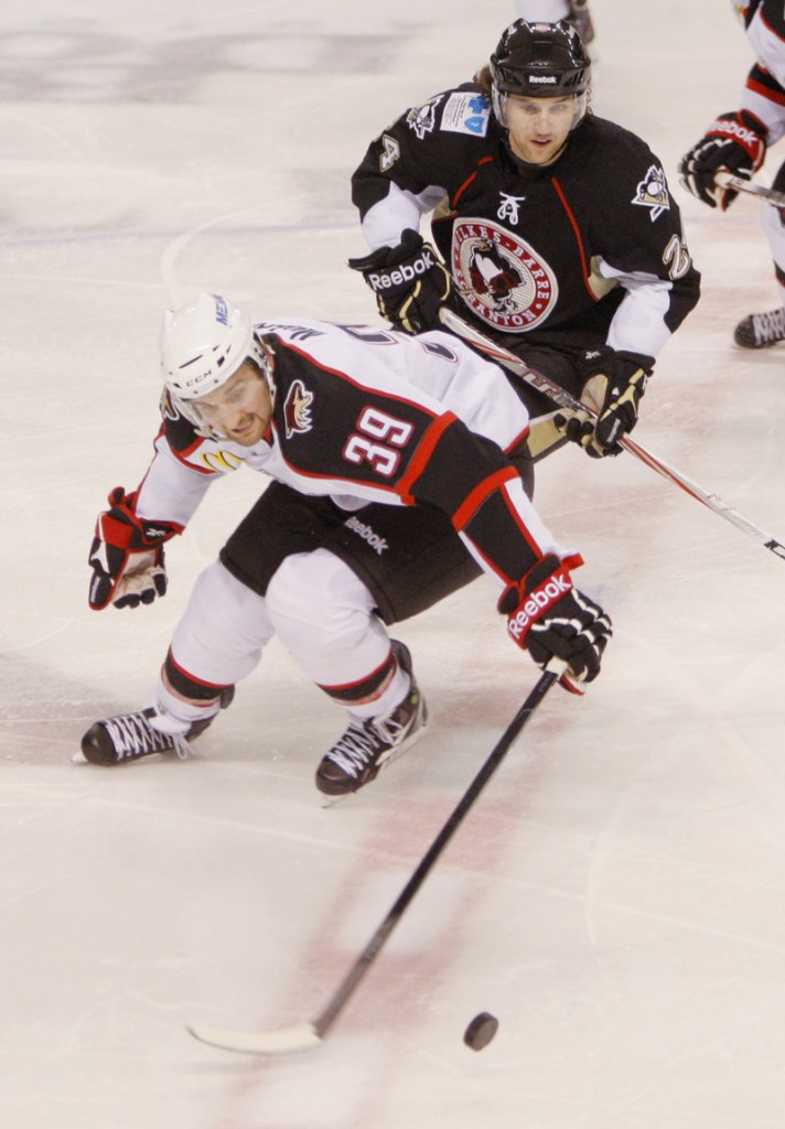 Brett MacLean of the Portland Pirates chases the puck Friday night ahead of Brandon DeFazio of the Wilkes-Barre/Scranton Penguins.