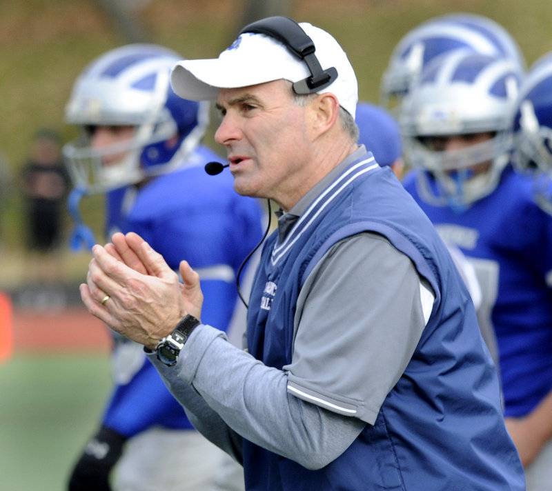 Coach John Hersom, whose family is renowned in Maine football, encourages his Lawrence team as they play Cheverus for the Class A state title Saturday.