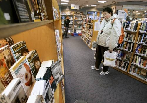 Stephanie Berry of Portland shops at Longfellow Books in Portland. The bookstore supports the city's