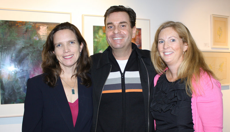 Jennifer Hutchins, executive director of Creative Portland, public relations consultant Rob Gould and Kristen Levesque, of the Portland Museum of Art. About 200 guests gathered Wednesday to tour and toast Portland's POP gallery.