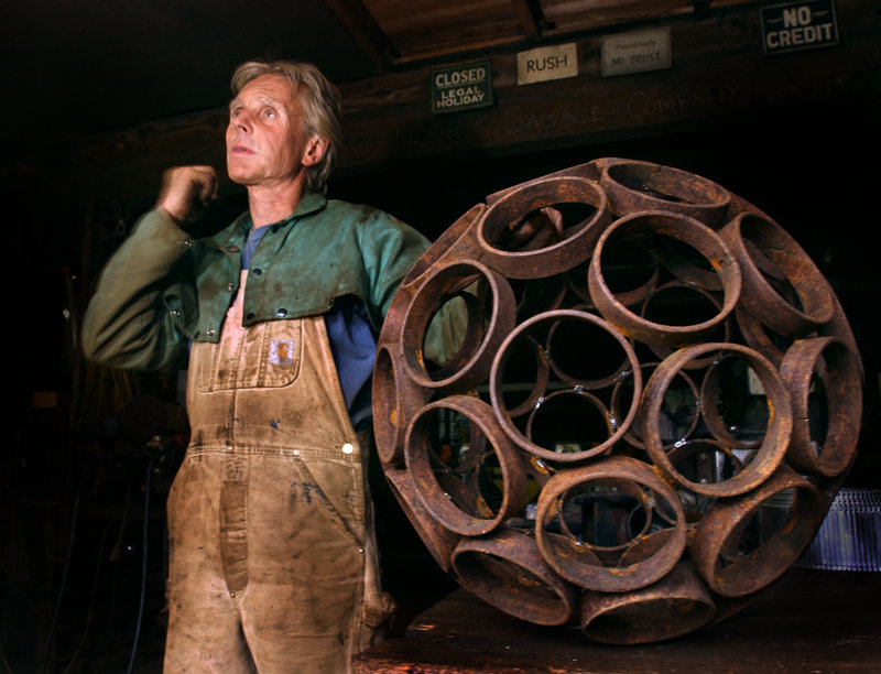 """In this 2004 file photo, Dave McLaughlin is shown with a spherical work like the one that Jay Sawyer incorporated into his piece """"Late Collaboration."""""""