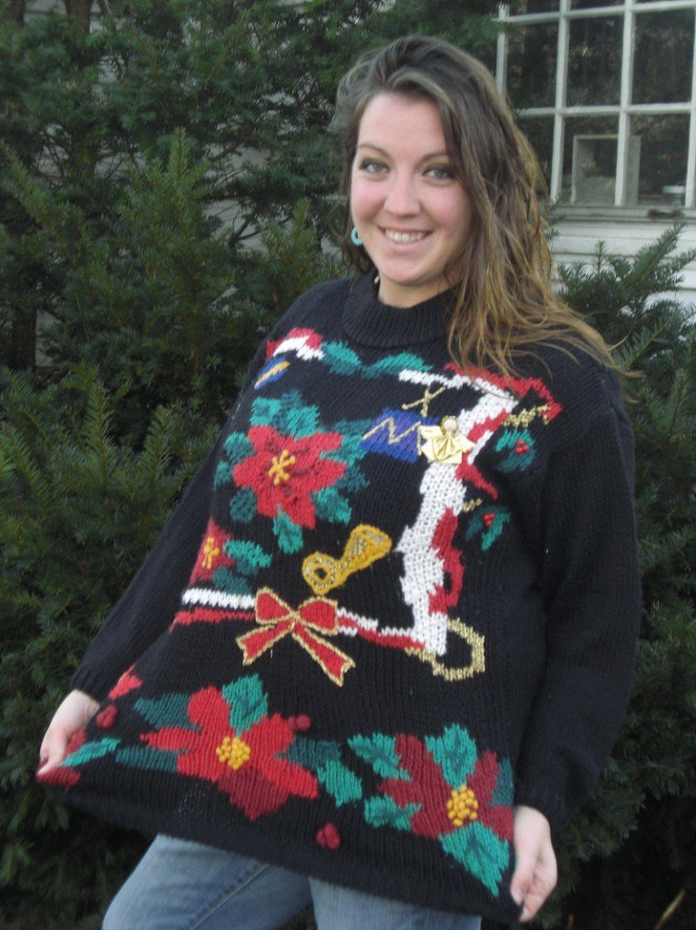 """Stacie Biddle is taking part in an effort to set a record for """"the most ugly holiday sweaters worn in one place at one time."""" Admission to Sunday's event in Wells will benefit Goodwill."""