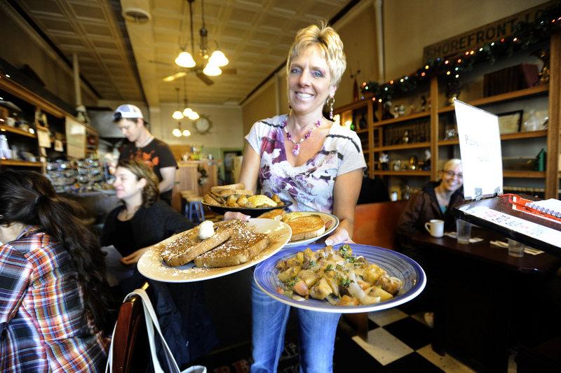 Server Debbie Thibodeau serves breakfast at Brea Lu in Portland.