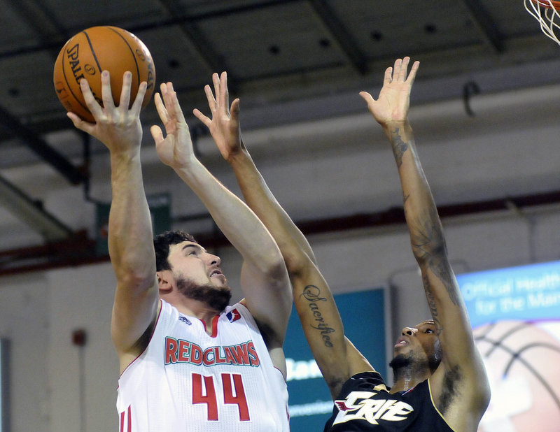 Dominic Calegari of the Maine Red Claws lifts a shot over Greg Washington of the Erie BayHawks during Erie's 109-105 victory Saturday.