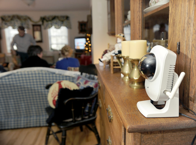 A webcam perched on the hutch between Patty Gardner's kitchen and living room is monitored at least four times a day as part of the elder-care services supplied by Full Circle America. Motion sensors in her bedroom and bathroom are also monitored.