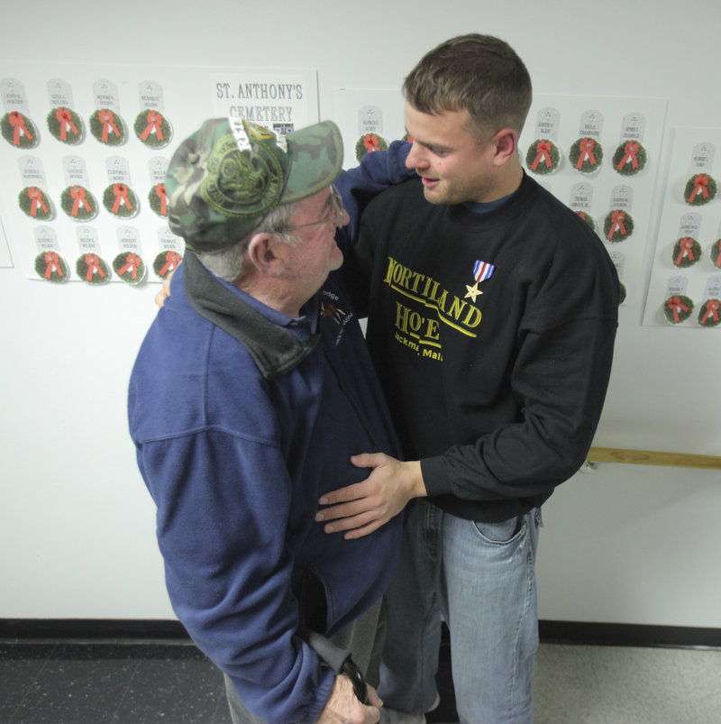 Another Silver Star hero from Jackman, Frank DuBois, hugs Sgt. Timothy Gilboe during a homecoming reception Thursday honoring Gilboe. DuBois received his Silver Star in 1968 during the Vietnam War.