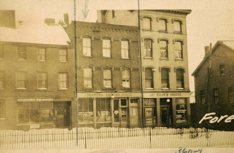 The historic block of buildings along Fore Street at Boothby Square, with 340 Fore St. at the far right in the 1924 archival image.
