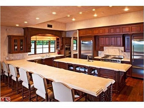 The open kitchen of Avril Lavigne's former home has plenty of seating for guests.