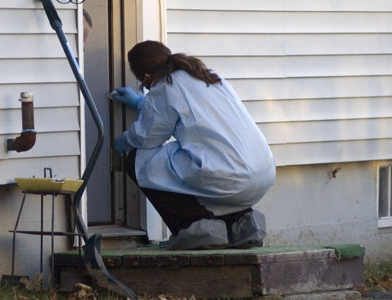 On Dec. 20, a member of the Maine State Police reconstruction team takes samples from the Violette Avenue home where Ayla last was seen.