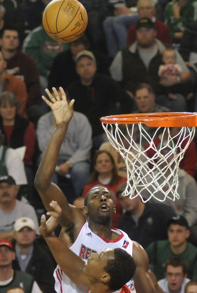 Anthony Kent watches his shot go in the basket Sunday for the Red Claws, who at one stretch went more than nine minutes without a point in their loss.