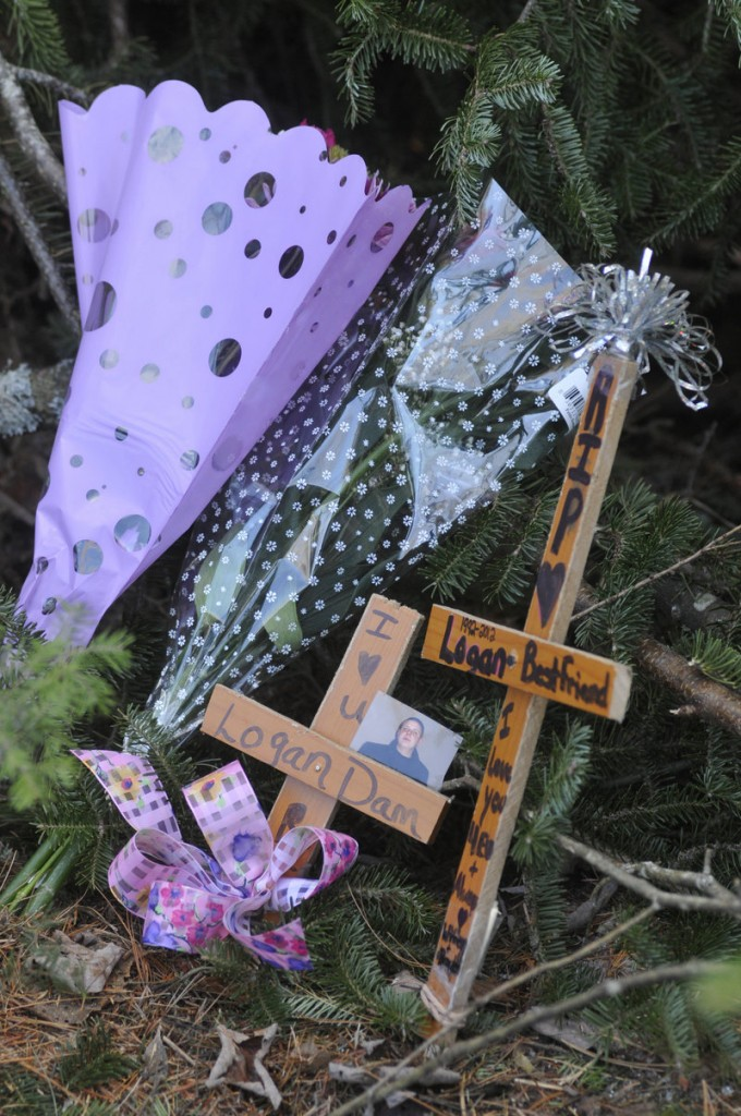 Two crosses left by friends at the scene of the crash on Route 219 in West Paris memorialize Logan Dam, 19, of Norway, who also was killed.