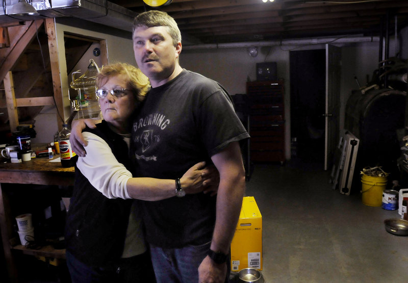 Jerrold Mason, father of Rebecca Mason, 16, who was killed in a car crash Saturday, is comforted by his mother-in-law, Monda Fahsholtz, at his home in West Paris on Sunday.