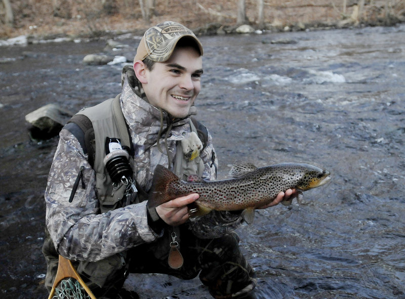 Dan Dykstra of Old Town shows off a brown trout he caught Jan. 8 in the Mousam River in Kennebunk during the ninth annual Freeze Up, a gathering of fly fishermen held each January.