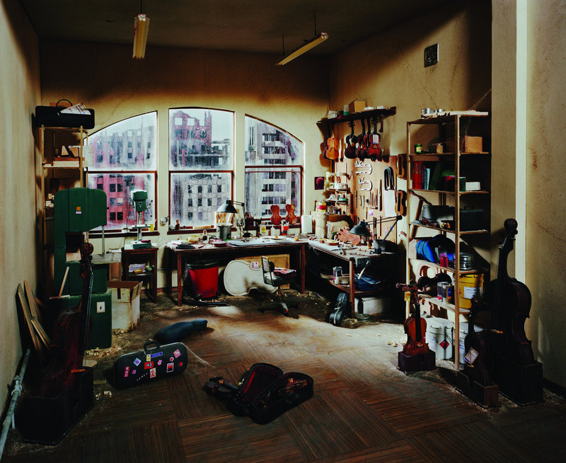 """""""Violin Repair Shop,"""" a photograph by Lori Nix from her exhibition """"The City,"""" on view through March 24 at the UMaine Museum of Art in Bangor."""