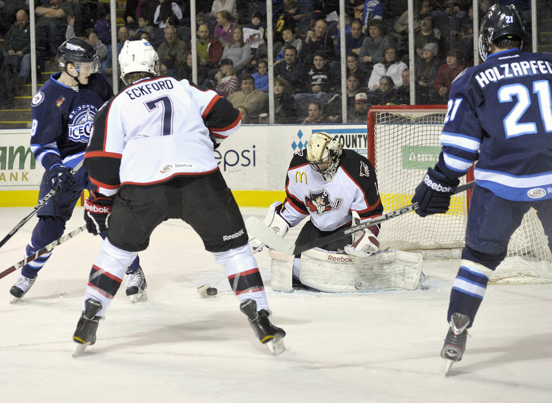 Pirates goalie Justin Pogge blocks a shot and covers up with traffic in front during Saturday night's game at the Cumberland County Civic Center. The Pirates won, 5-2.