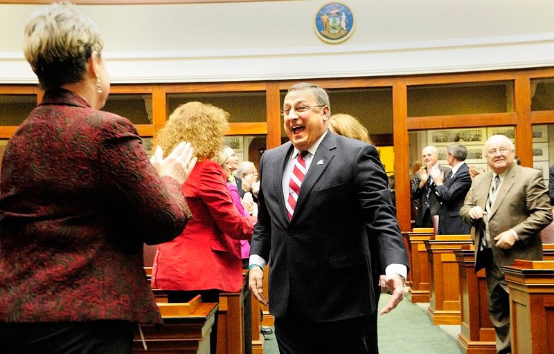 Gov. Paul LePage greets Rep. Joyce Maker, R-Calais, as he walks down the aisle in the State House to give his first State of the State address on Tuesday evening in Augusta.