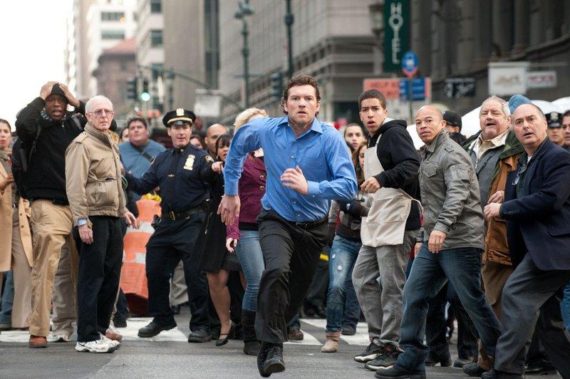 """Sam Worthington on the run in """"Man on a Ledge."""""""